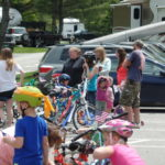 Memorial day weekend activities include bike decorating, face painting, bouncy house, horse lead parade.
